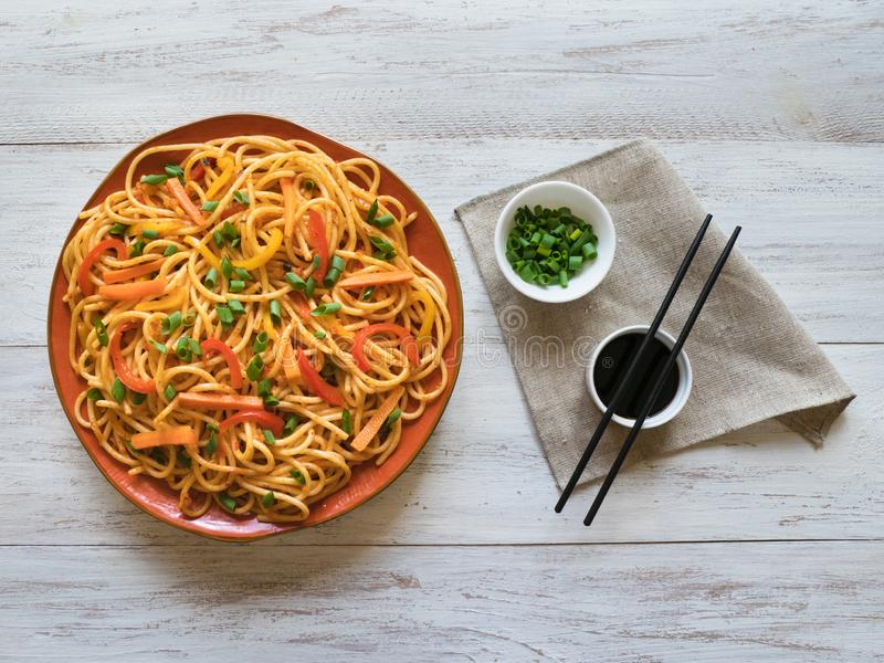 Hakka Noodles is a popular Indo-Chinese recipes. Schezwan Noodles with vegetables in a plate. Top view stock photos