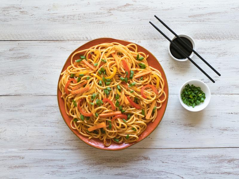 Hakka Noodles is a popular Indo-Chinese recipes. Schezwan Noodles with vegetables in a plate. Top view stock photography
