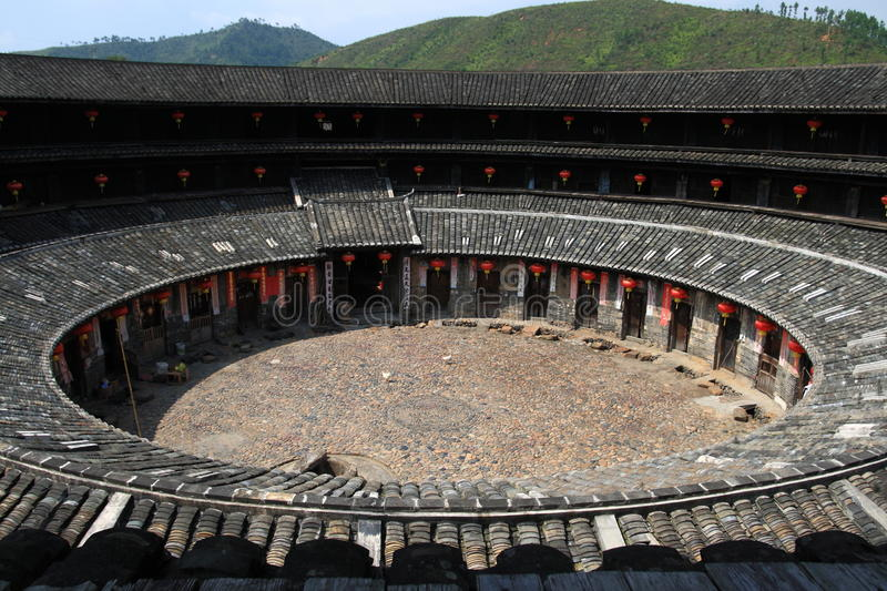 Hakkas soil building look down. Look down The round hakkas soil building with red lantern in China royalty free stock photography