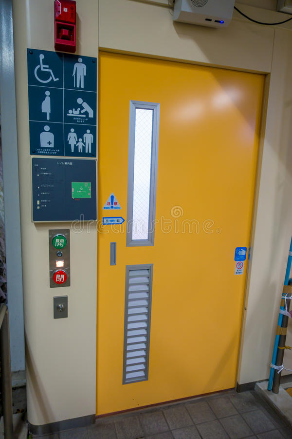 HAKONE, JAPAN - JULY 02, 2017: Technologic bathroom at the interior of train during rainy and cloudy day.  stock photo