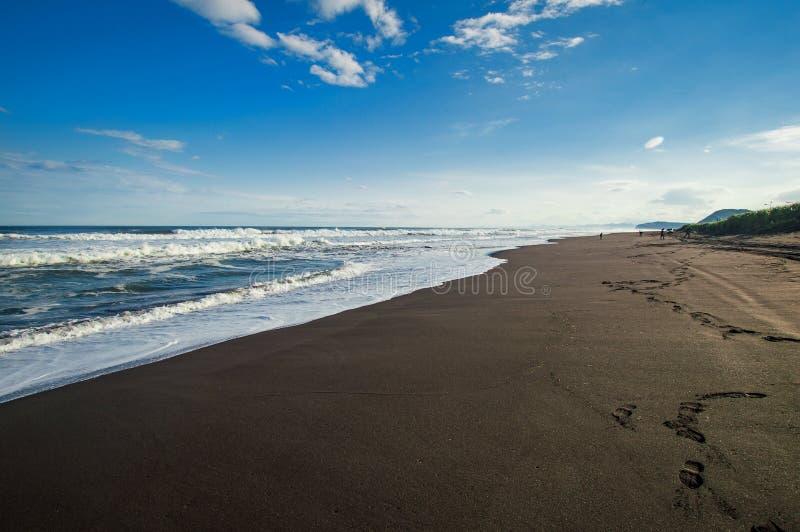 Halaktyr strand kamchatka Rysk federation För mörker för svartfärg nästan strand för sand av Stilla havet Stenberg och arkivfoto