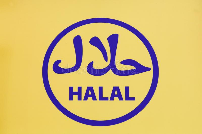 Halal food sign. On a wall royalty free stock image