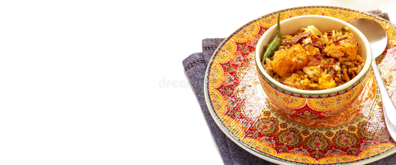 Halal Indian chicken Biryani served with yogurt tomato raita over white background. Selective focus. Banner size royalty free stock photos