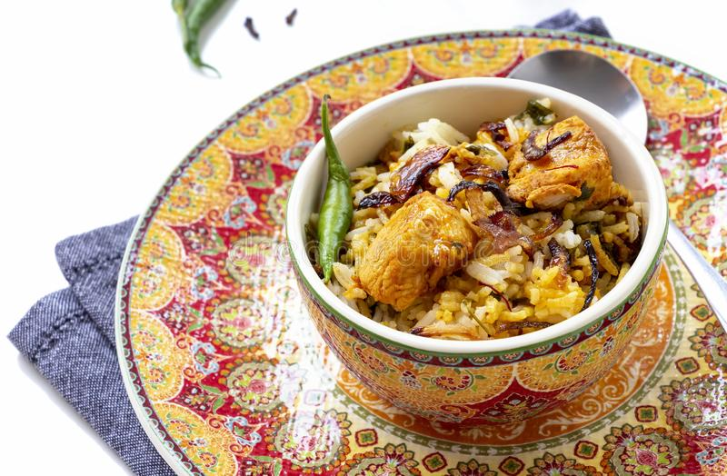 Halal Indian chicken Biryani served with yogurt tomato raita over white background. Selective focus.  stock photos