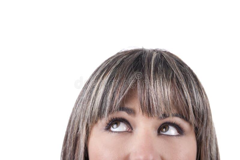 Halbes Gesicht der Geschäftsfrau mit den Augen, die oben schauen lizenzfreies stockfoto