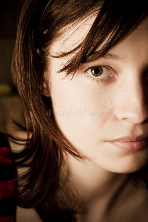 Halbes Gesichtsportrait stockfoto