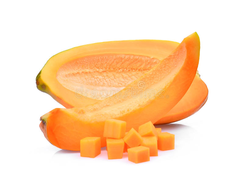 Half adn slice of fresh papaya with cubes isolated on white royalty free stock photo