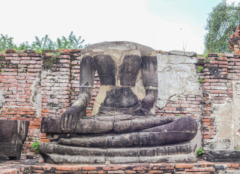 A half of Ancient Buddha statue royalty free stock images
