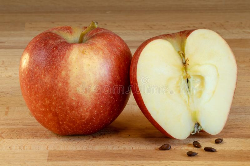 Half of and apple with one whole apple royalty free stock images