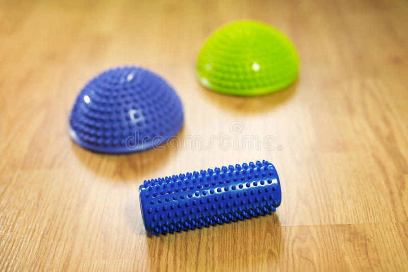 Half balance massage balls and rubber roller for flat feet correction stock images