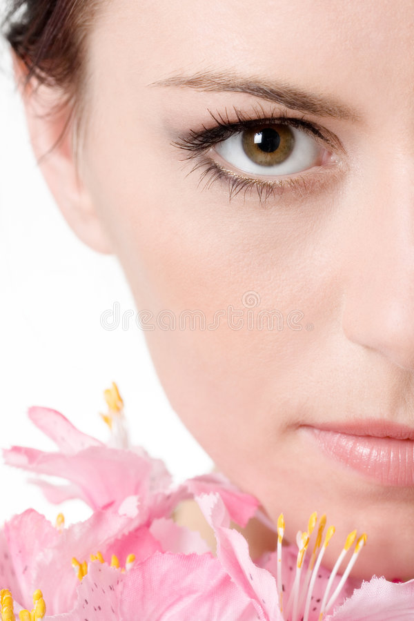 Half of the beautiful face. Half of the face of beautiful girl with flower royalty free stock image