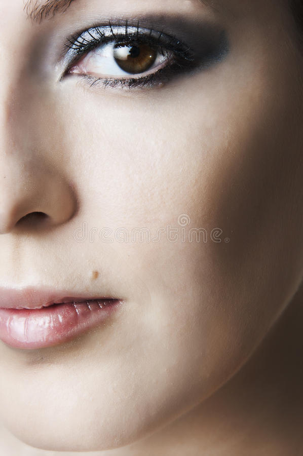 Half of beauty female face stock image