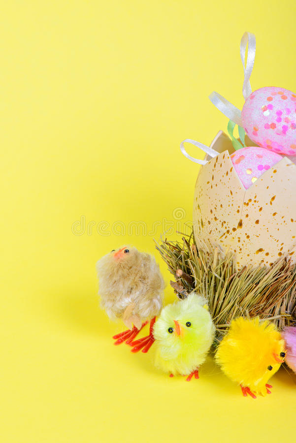 Half of big easter egg and small chickens royalty free stock photography