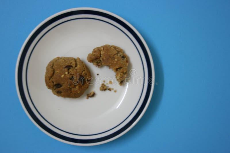 Half bitten biscuit royalty free stock image
