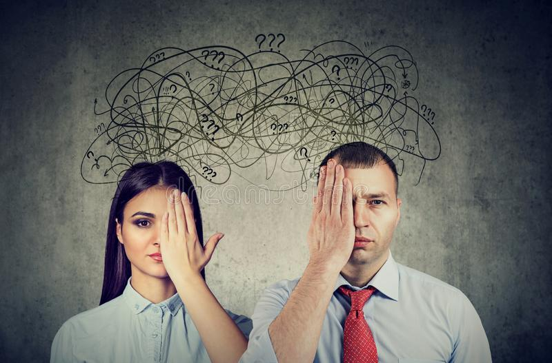 Half blindfolded couple having communication problems and share anxious thoughts. Half blindfolded couple a men and a women having communication problems and stock photography