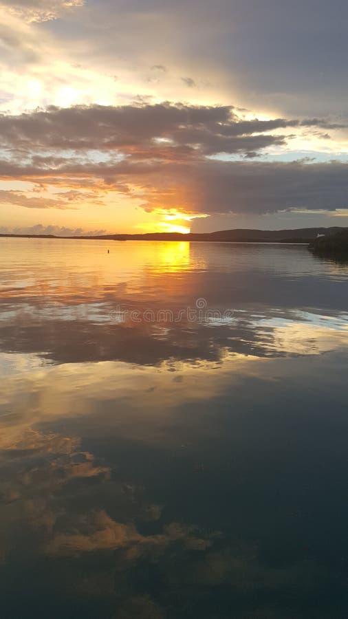 Half blocked sunset. Caribbean sunset that looks airbrushed stock photos