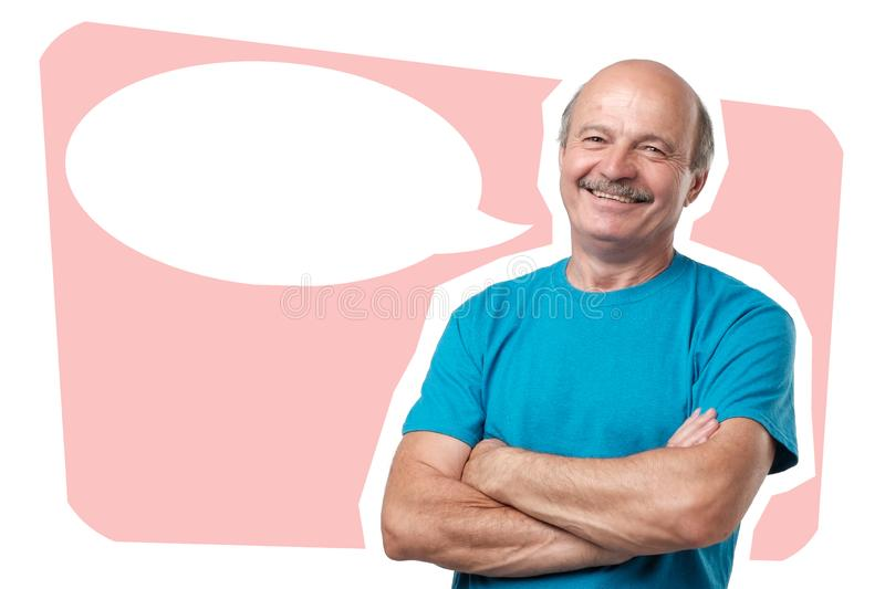 Half body portrait of confident caucasian middle aged man with folded arms looking at camera. Standing on ponk background with bubble copyspace for text stock photos