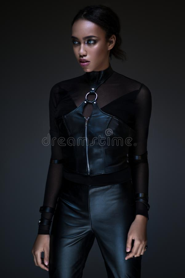 Half body view of black woman with gothic outfit royalty free stock image