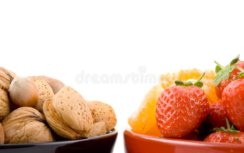 Half bowl with mixed fruits and nuts stock images