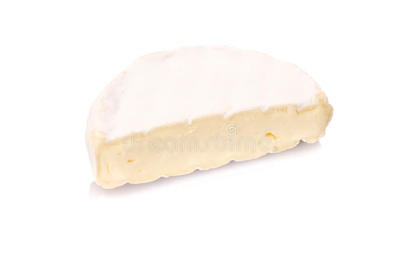 Half camenbert cheese diary product. Half french camenbert cheese diary product on white isolated background royalty free stock photos