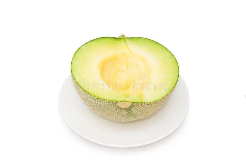 Half of cantaloupe melon isolated on white background.  royalty free stock photography