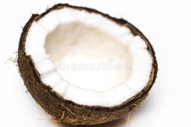 Half coconut top view isolated on white.  royalty free stock photo