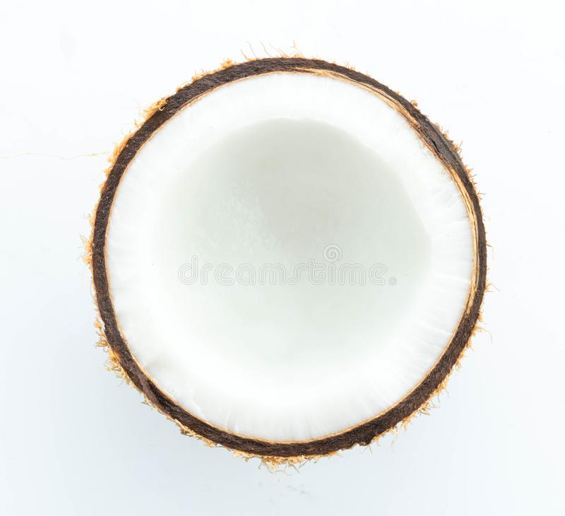 Half coconut top view isolated on white. Background royalty free stock photos