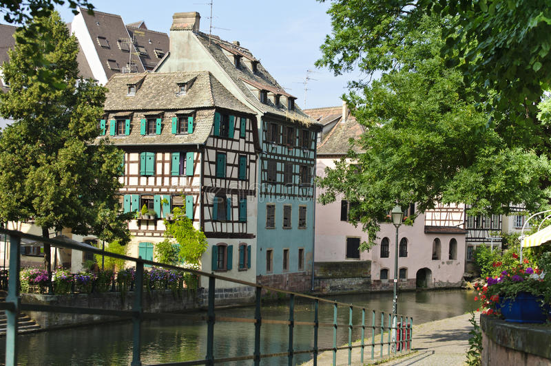 Half of colorful wooden houses along the canals of Strasbourg royalty free stock images