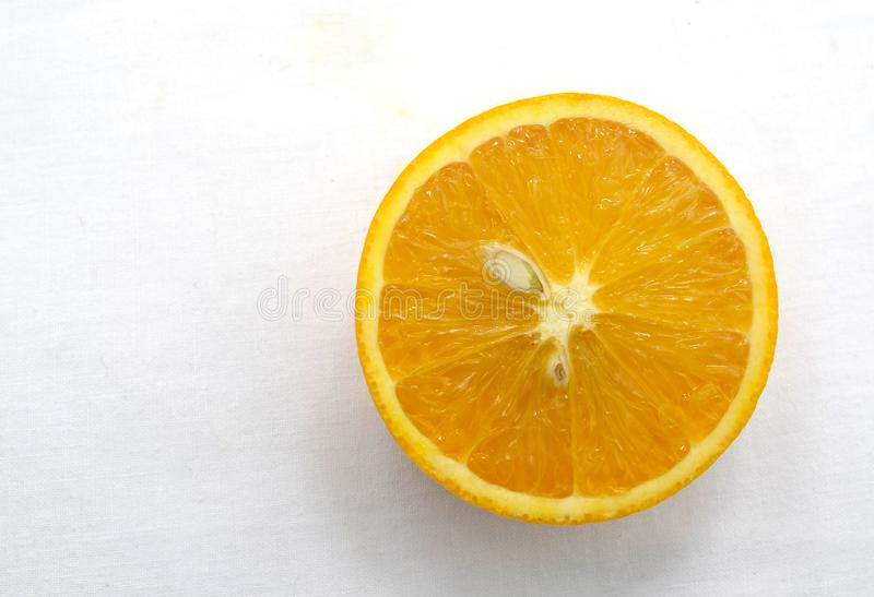 Half cut of orange fruit on white background royalty free stock image