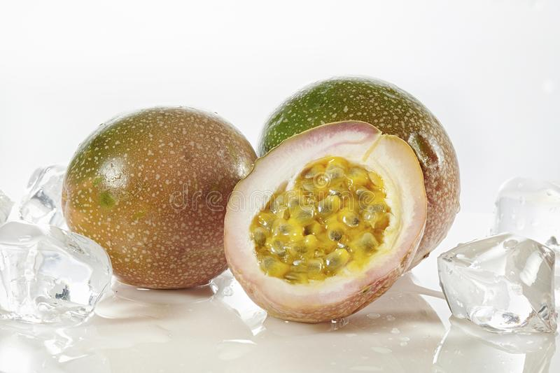 Half cut  passion fruit with ais isolated on white. Half cut passion fruit isolated on white background with ais stock image