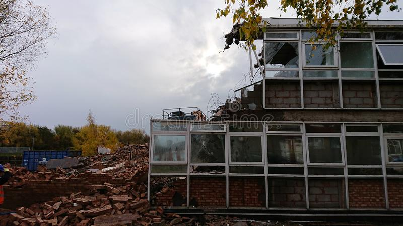 Demolished Building. A half demolished building showing rubble to the left and the remains of the still standing building royalty free stock photography