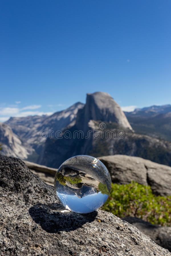 Half dome reflected inside a crystal sphere, Yosemite National Park royalty free stock images