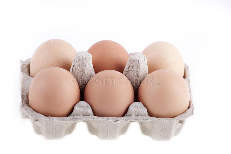 Half dozen fresh eggs in box stock image