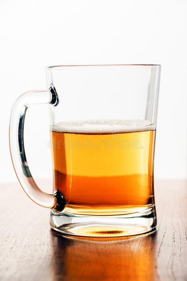Glass of Beer on a Wooden Table royalty free stock photos