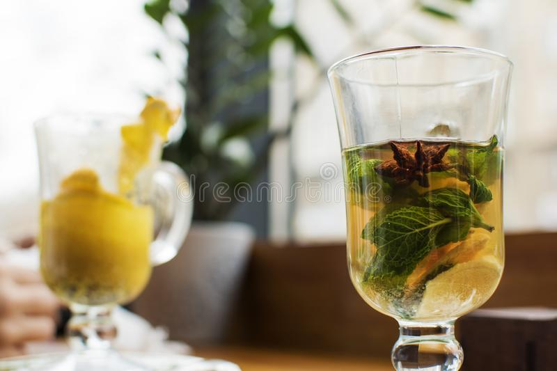Half empty glass of black tea on the trasitional black and blue stock photo