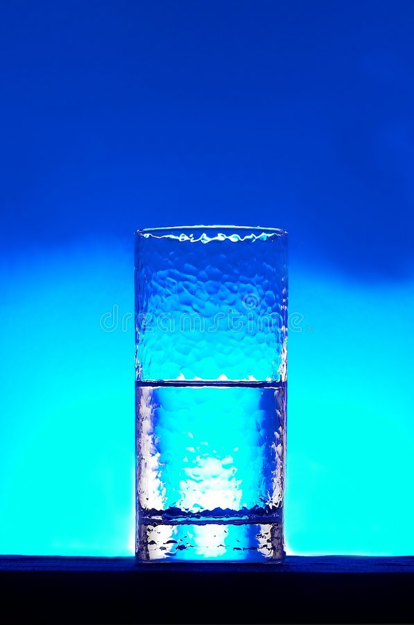 Half empty half full. Water in a glass royalty free stock images