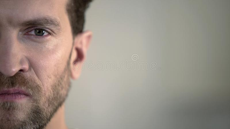Half face of aggressive man looking with hatred into camera, domestic tyrant. Stock footage royalty free stock photo