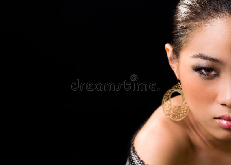 Half face Asian woman royalty free stock photo