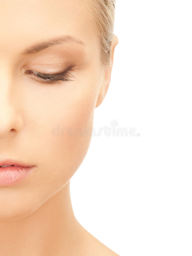 Half face of beautiful woman royalty free stock photography