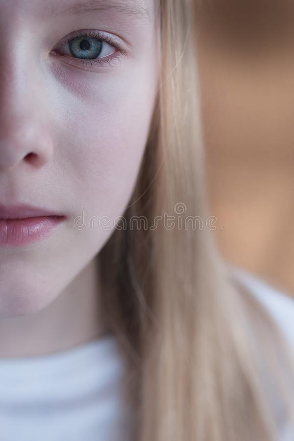Half face of a beautiful young girl royalty free stock images
