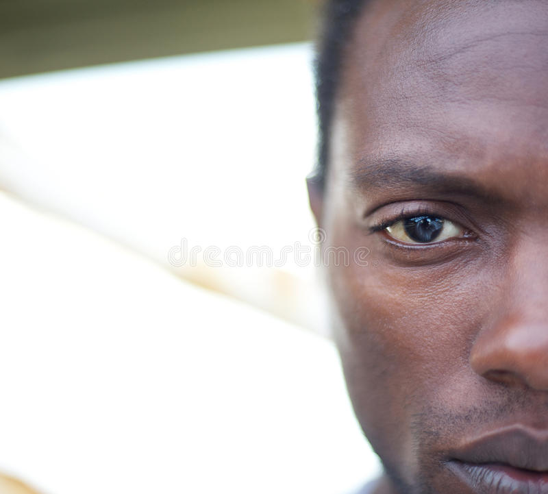 Half face portrait of an african american man stock photography