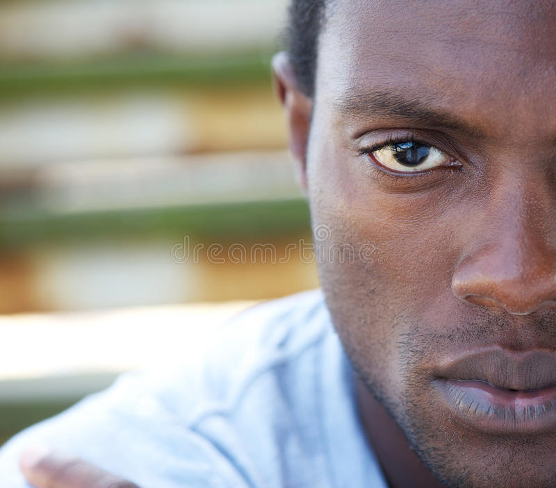 Half face portrait of an african american man. Outdoors royalty free stock photos