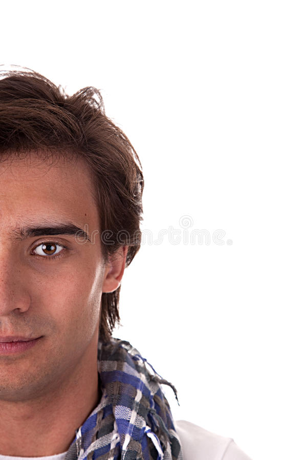 Half face of portrait of a handsome young man royalty free stock images