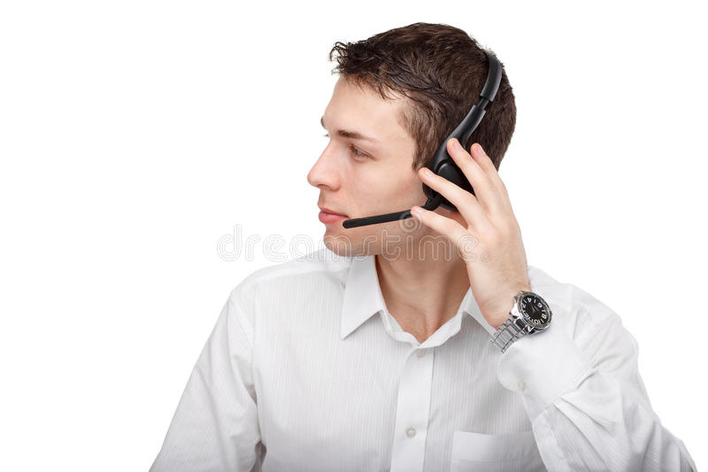 Half-face portrait of male customer service representative or ca. Close-up profile portrait of male customer service representative or call center worker or royalty free stock image