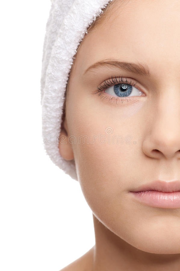 Half face shoot of girl with towel royalty free stock photography