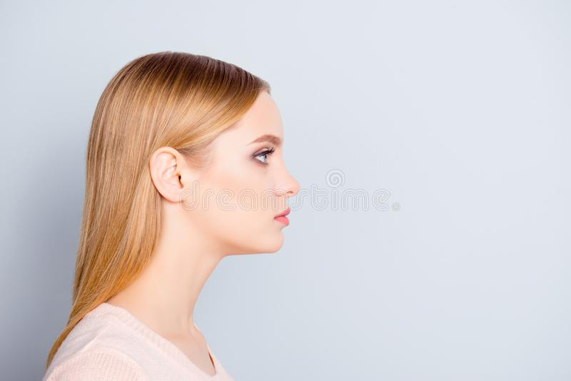 Half-faced profile side view close up portrait of serious confident focused concentrated thinking pondering pretty cute lovely ma royalty free stock photos