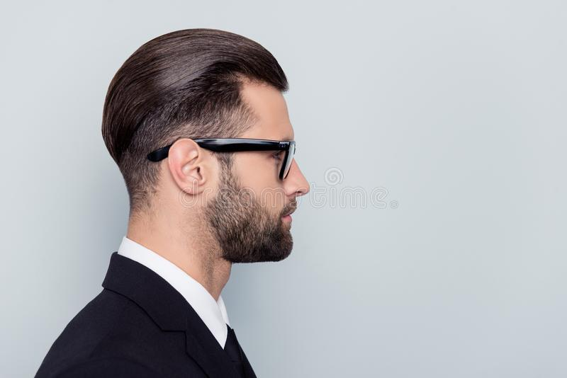 Half-faced profile side view close up portrait of serious focused handsome attractive style stylish modern masculine guy with stock images