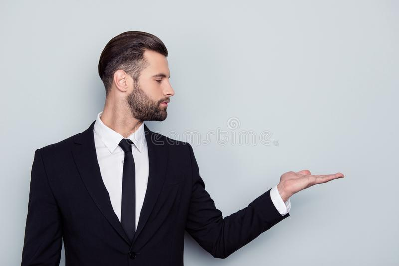 Half-faced serious confident satisfies smart modern stylish hand. Some concentrated expert financier banker broker representative holding empty blank place space royalty free stock photo