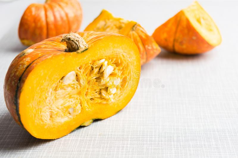 Half of fall pumpkin. Autumn traditional vegetable. Natural healthy organic food stock photography