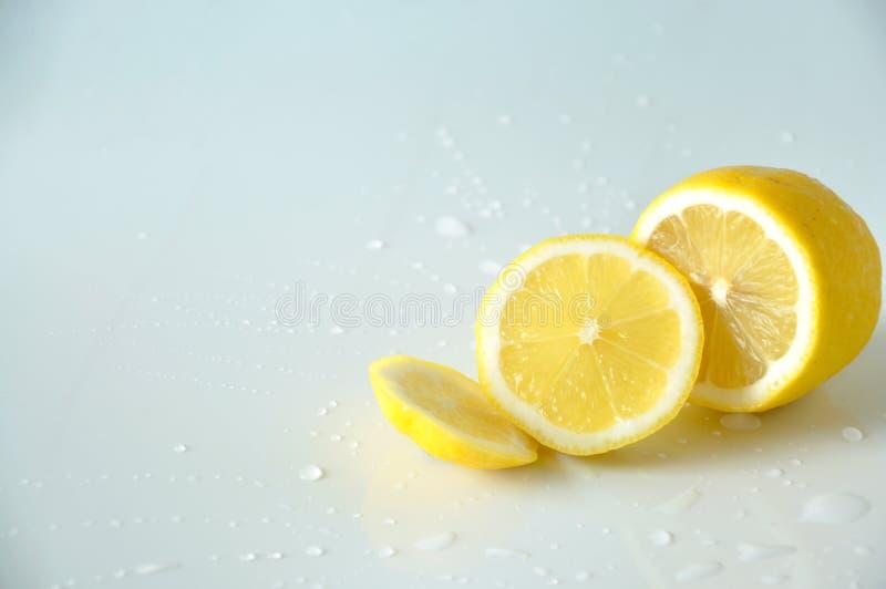 Half of Fresh Lemon Pieces on White Background stock photos
